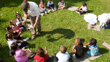 Photo of children sitting in a circle